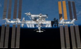 A path to a commercial orbital debris cleanup, power-beaming, and communications utility, using technology development missions at the ISS