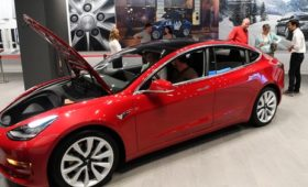 Tesla unveils $35,000 Model 3, sees first quarter loss