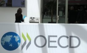 OECD cuts global growth forecast on Brexit, trade rows