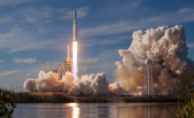 Denial, disruption, and development in the space launch business