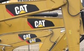 Caterpillar beats profit estimates, raises forecast