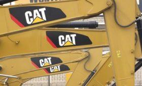 Caterpillar beats profit estimates, raises forecast