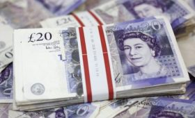 Sterling rises as May faces pressure on Brexit