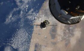 Soyuz crew docks with International Space Station