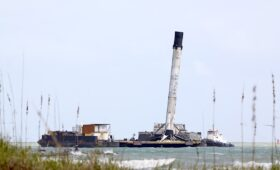 Crew-rated SpaceX booster returns to Cape Canaveral with a lean