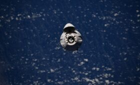 Dragon supply freighter docks at space station with 2.4 tons of cargo